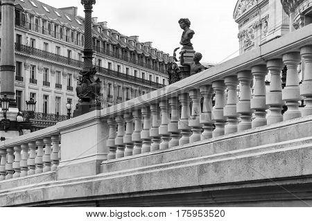 Architectural details of Opera National de Paris: West facade and monument to Charles Garnier the architect of Paris Grand Opera in black and white. Grand Opera (Opera Garnier) is famous neo-baroque building in Paris.