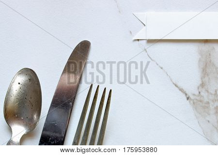 Vintage silverware set with blank place card