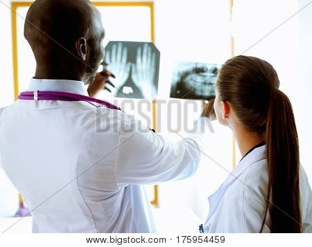 Doctors analyzing an x-ray in a metting