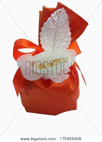 Red gift bag with flower isolated on white background.  Gift pouch