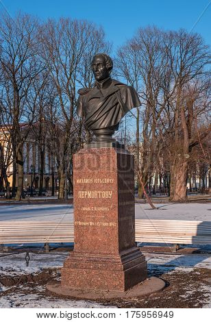 St. Petersburg, Russia - March 5, 2017: Monument to the poet Lermontov in the park in front of the Main Admiralty. In the background is the Admiralty.