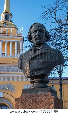 St. Petersburg, Russia - March 5, 2017: Monument to the composer Glinka in the park in front of the Main Admiralty. In the background is the Admiralty.
