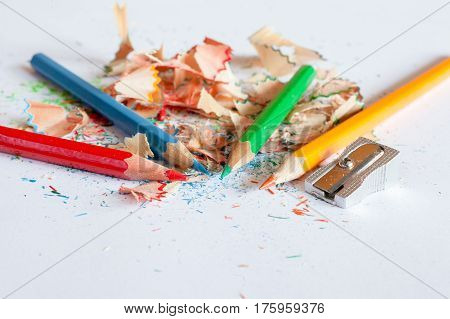 Sharpener And Four Crayons On A Scrap Of Sharpening
