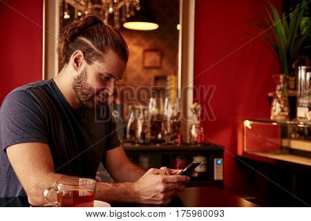 Grinning Young Man In A Bar