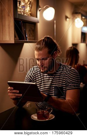 Goodlooking Young Man With His Tablet