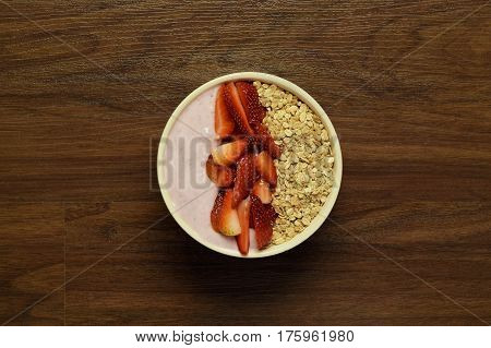 Bowl Of Muesli On A Wooden Table.