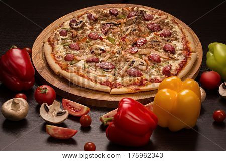 Pizza Hunting, mozzarella, hunting sausages, beef, chicken, smoked, gherkins, mushrooms isolated on black background