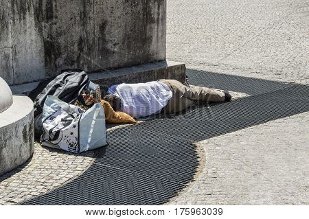 Fired businessman unemployment sleeping on the street in waiting for a job