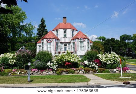 HARBOR SPRINGS, MICHIGAN / UNITED STATES - AUGUST 4, 2016: The Hexagon House, designed by Ephraim Shay as his home in 1892, has 6 hexagonal rooms on the ground floor, and was constructed of stamped steel.