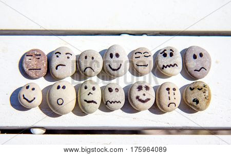 Smiley face on the small rock pebbles