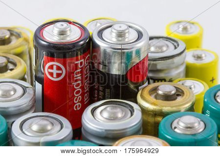 Alkaline Batteries With Selective Focus On Two Red-black Protruding Batteries