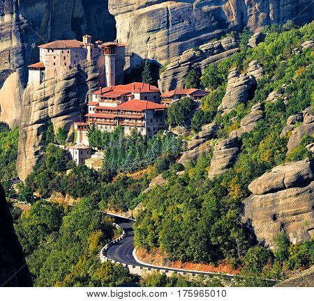 Roussanou monastery at Meteora Greece with road and rocks