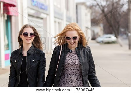 Two Female Friends Having Fun Outside In The City
