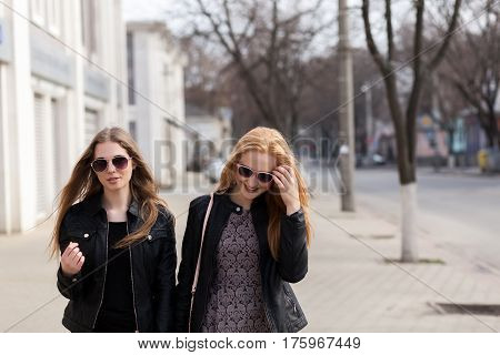 Two Female Friends Having Fun Outside In The City