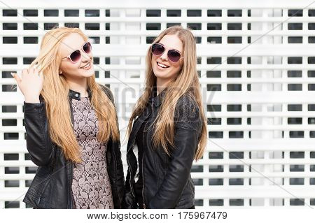 Two Beautiful Girl Friends Having Fun Outside In The City