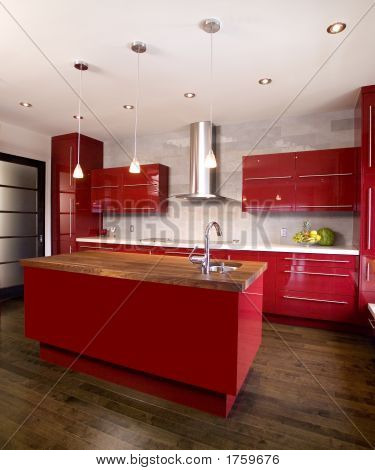 Modern Red Kitchen With A Dark Wooden Island