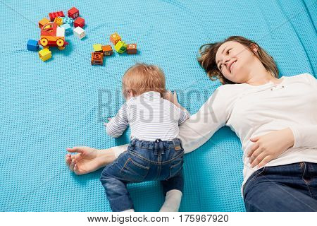 Mother Playing With Her Son In The House