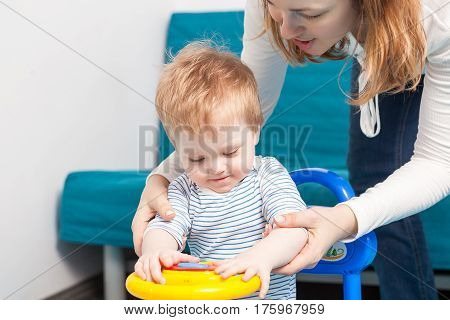 Child Playing With Her Mother At Their Home