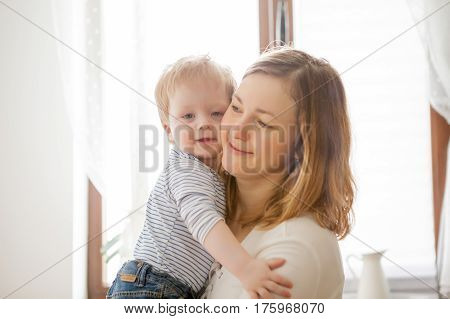 Beautiful Mother Playing With Her Son At Kitchen