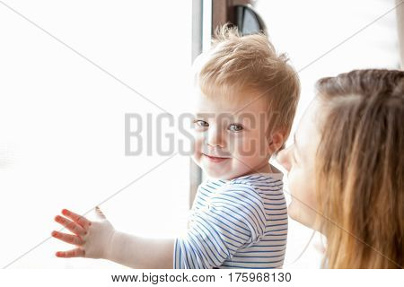 Mother And Child At The Window