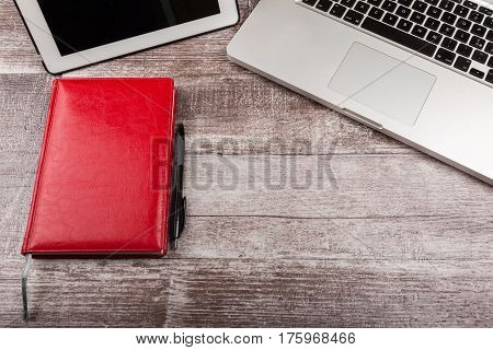 Laptop And A Notebook For Writing