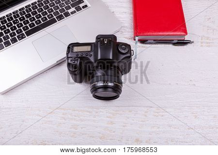 Over Top Photo Of Dslr Camera And Laptop