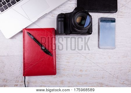 Over Top Photo Of Dslr Digital Camera And Laptop