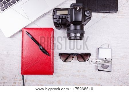 Laptop, Writing Notebook, Camera And Musical Player