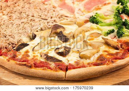 Four Seasons Pizza, mozzarella, onion, ham, tuna, broccoli, mushrooms, button mushrooms isolated on white background
