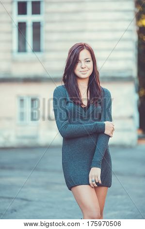 Portrait of beautiful girl in grey skinny dress