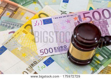 Wooden Hammer With Euros Bills On Desk.