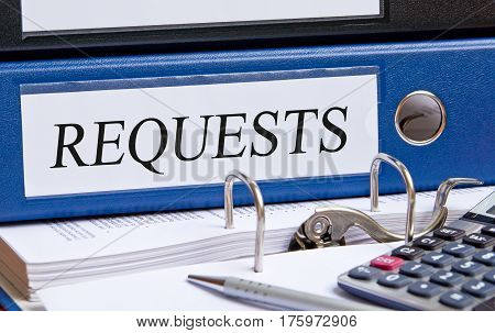 Requests - blue binder on desk in the office