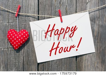 Happy Hour - postcard with red heart on wooden background