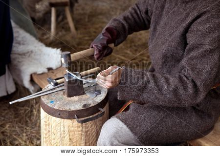 The annual festival in Kolomenskoye. Reconstruction of Ancient Rus. Blacksmith working process