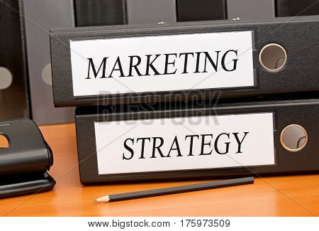 Marketing and Strategy - two binders on desk in the office