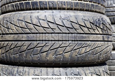 stack of used car tires, front view
