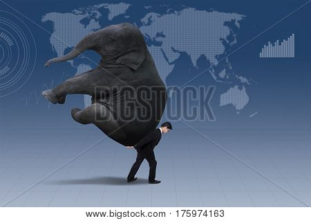 Image of businessman carrying heavy elephant over world map