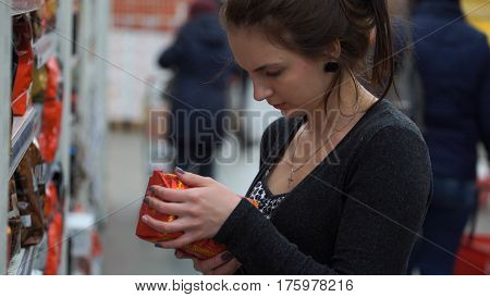 Woman buys coffee in a supermarket or store