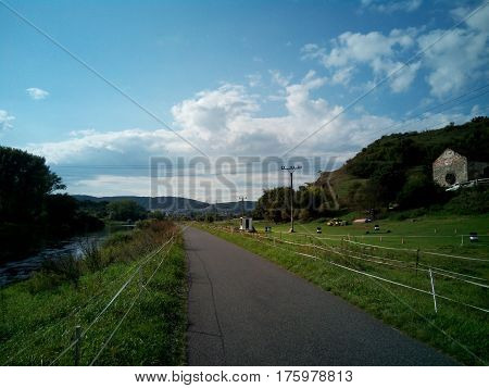 walk along the cycle path on a sunny day in the open air