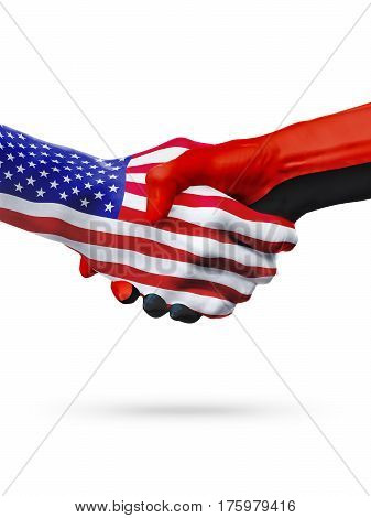 Flags United States and Angola countries handshake cooperation partnership and friendship or sports competition isolated on white