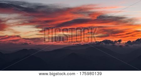 Formation of clouds paint the sky red at sunset. Park of the Monti San Vicino and Canfaito Italy