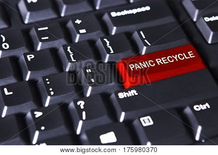 Image of red button with text of panic recycles on the computer keyboard