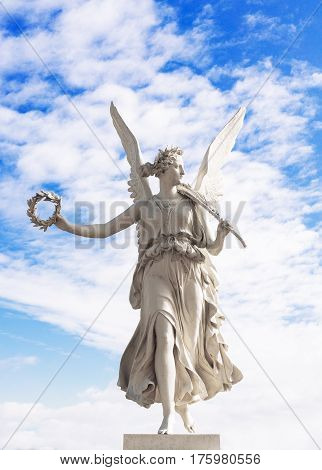 Statue of the goddes Nike blue sky and clouds angel from Schwerin Castle garden Germany