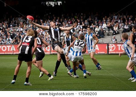 MELBOURNE - APRIL 2: Collingwood's Darren Jolly stretches for the ball in a ruck contest in their win over North Melbourne  at Etihad Stadium Docklands - April 2, 2011 in Melbourne, Australia