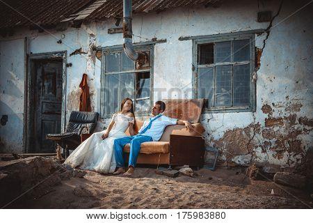 Wedding couple near an old fishing house on the beach