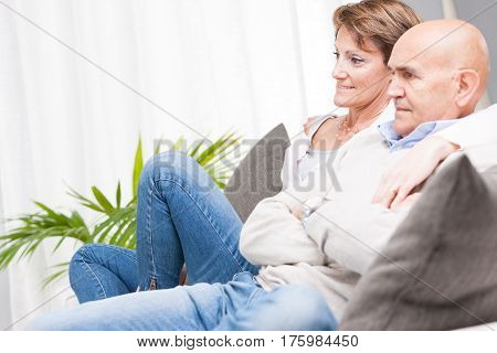 Middle-aged Couple Relaxing Watching Television