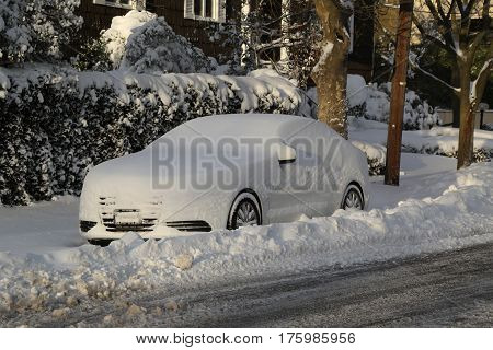 BROOKLYN, NEW YORK - FEBRUARY 9, 2017: Car under snow in Brooklyn, NY after massive Winter Storm Niko strikes Northeast.