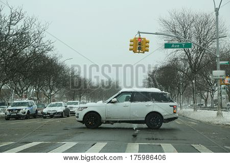 BROOKLYN, NEW YORK - FEBRUARY 9, 2017: Cars crossing Ocean Parkway in Brooklyn, NY after massive Winter Storm Niko strikes Northeast.