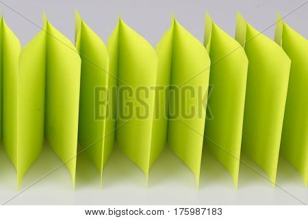 abstract green paper fence on white - sticky notes paper