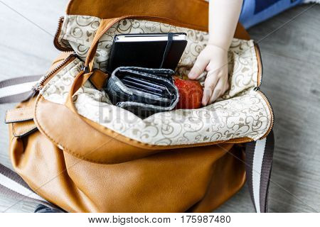 inside woman leather handbag on the wooden floor